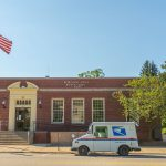 Borough hall in downtown north east with a postal truck out front of it