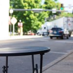 empty table outside of a business downtown in North East