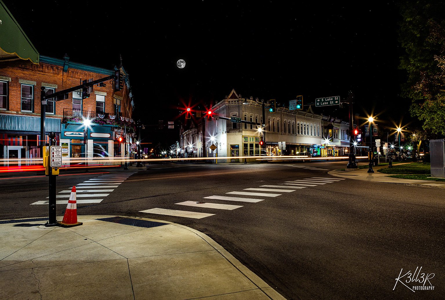 downtown North east at night with a light trail