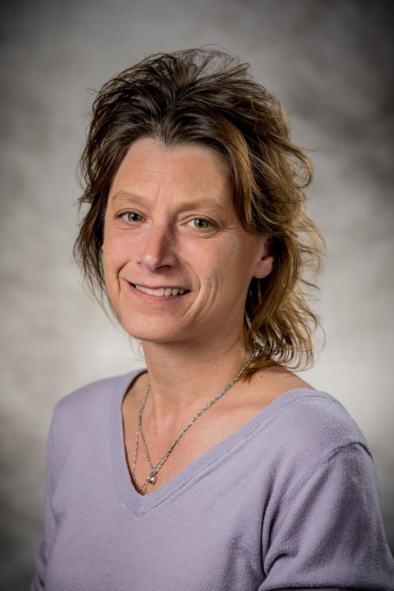 woman wearing light purple shirt