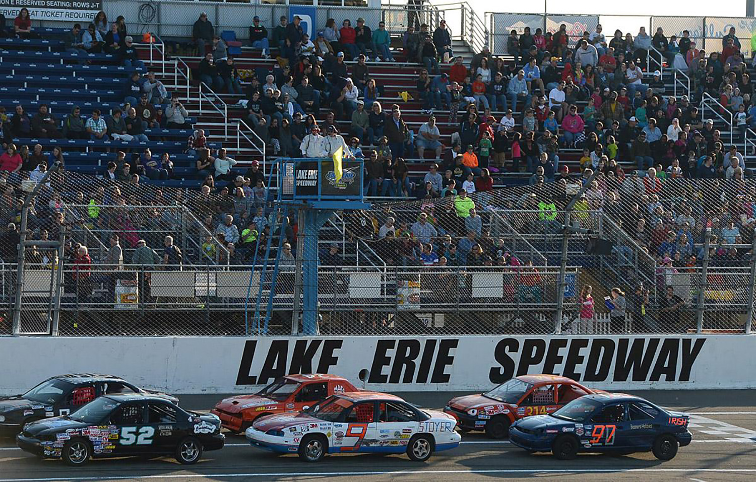 cars racing on the speedway at Lake Erie Speedway